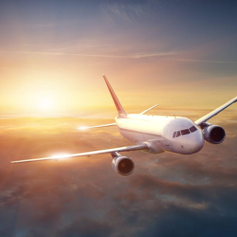 My Tips for When your Partner Travels with Work - Airplane in the sky at sunset