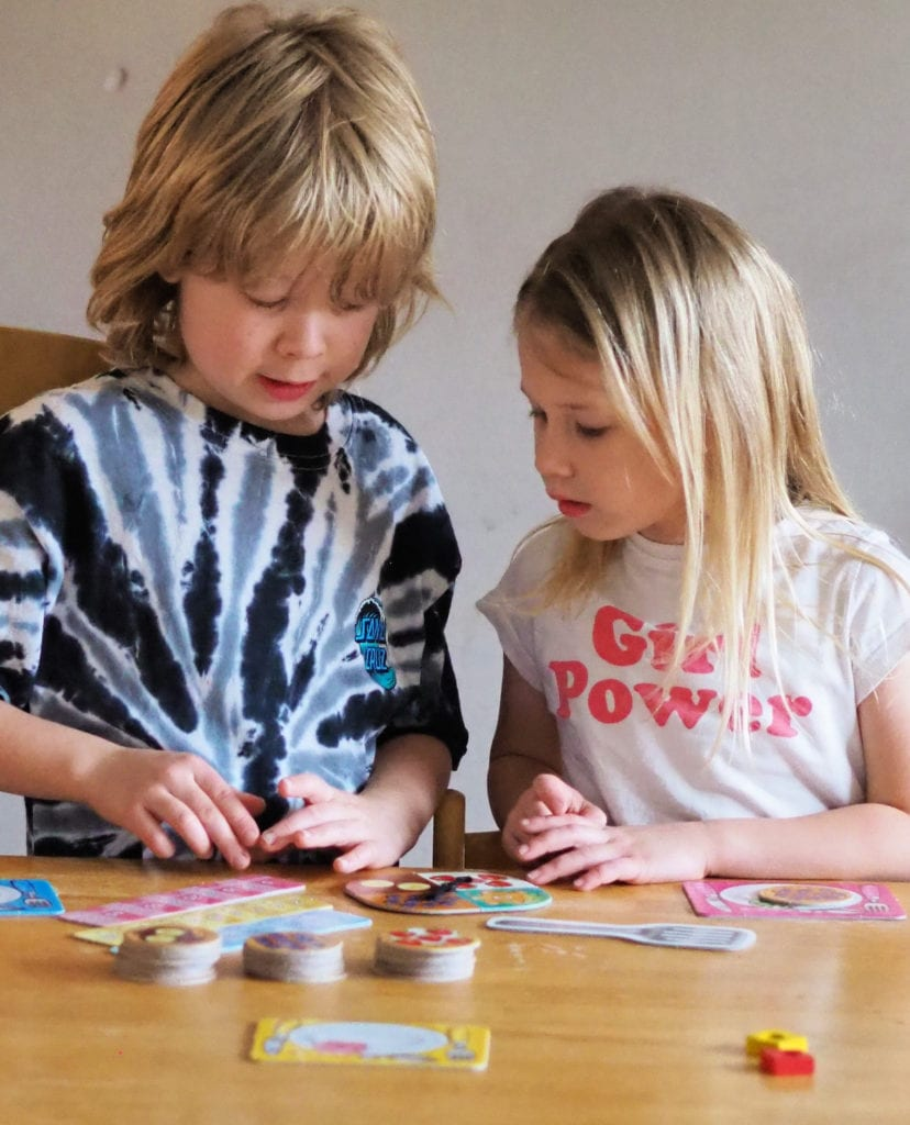 Aria and Logan playing times tables board game