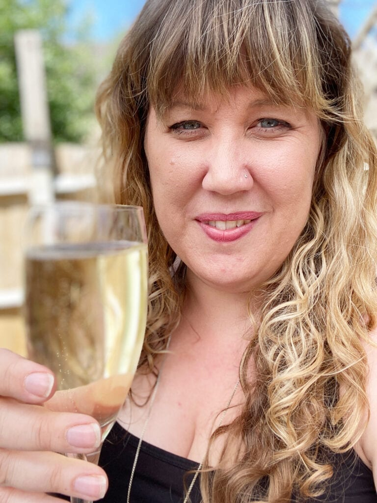A picture of me holding a glass of prosecco