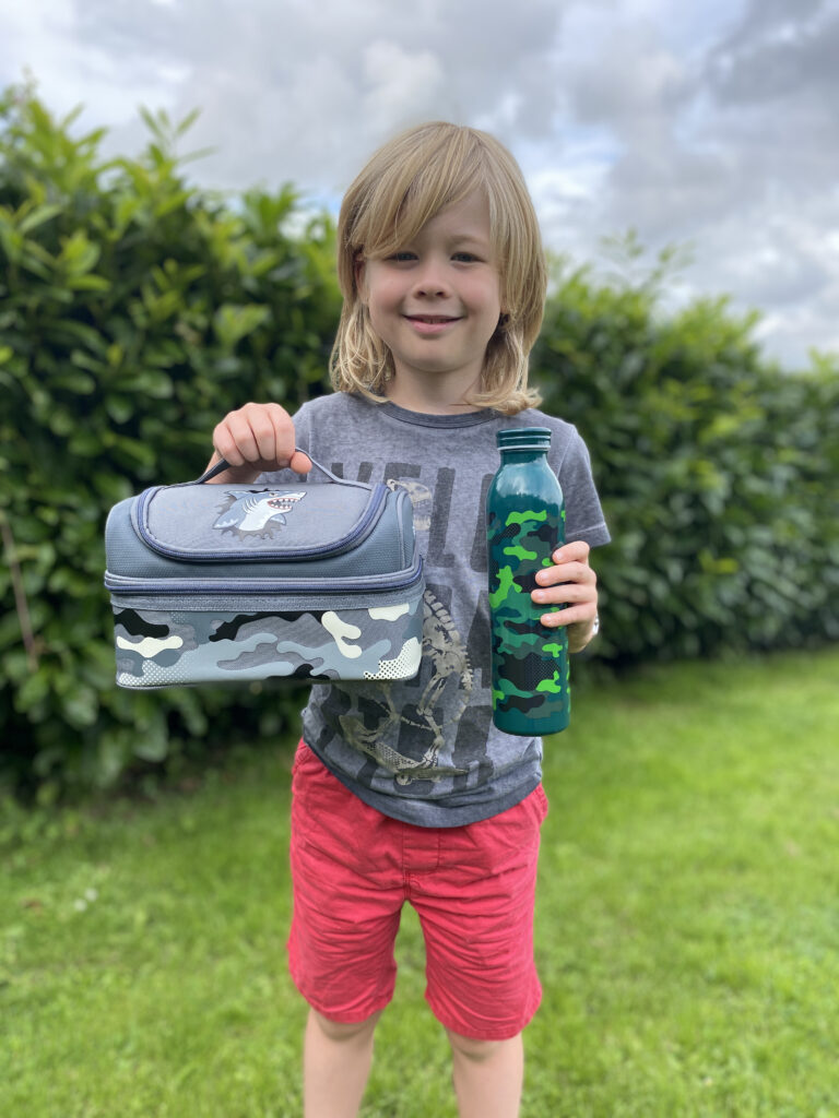 Logan with Smiggle budz shark lunch box and water bottle