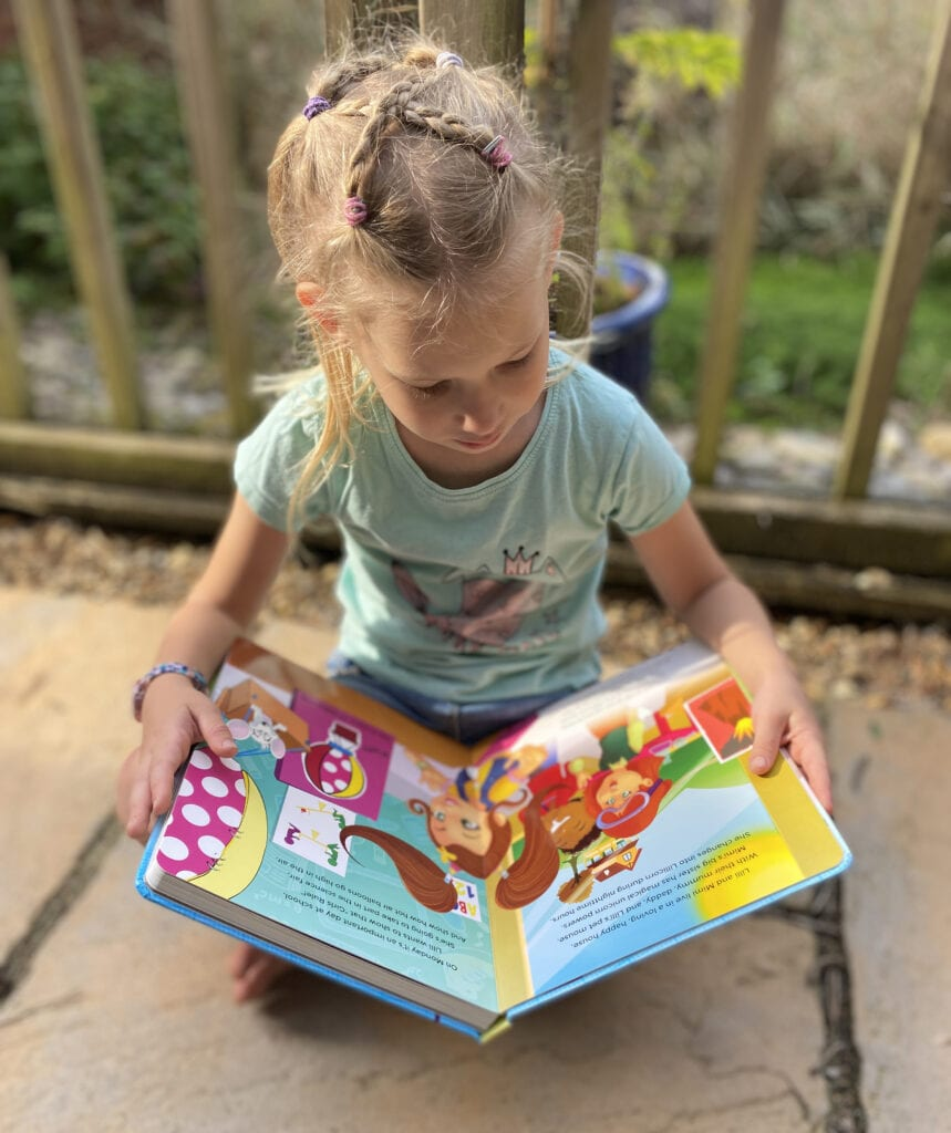 Aria reading The Adventures of Lillicorn in WooWoo Land