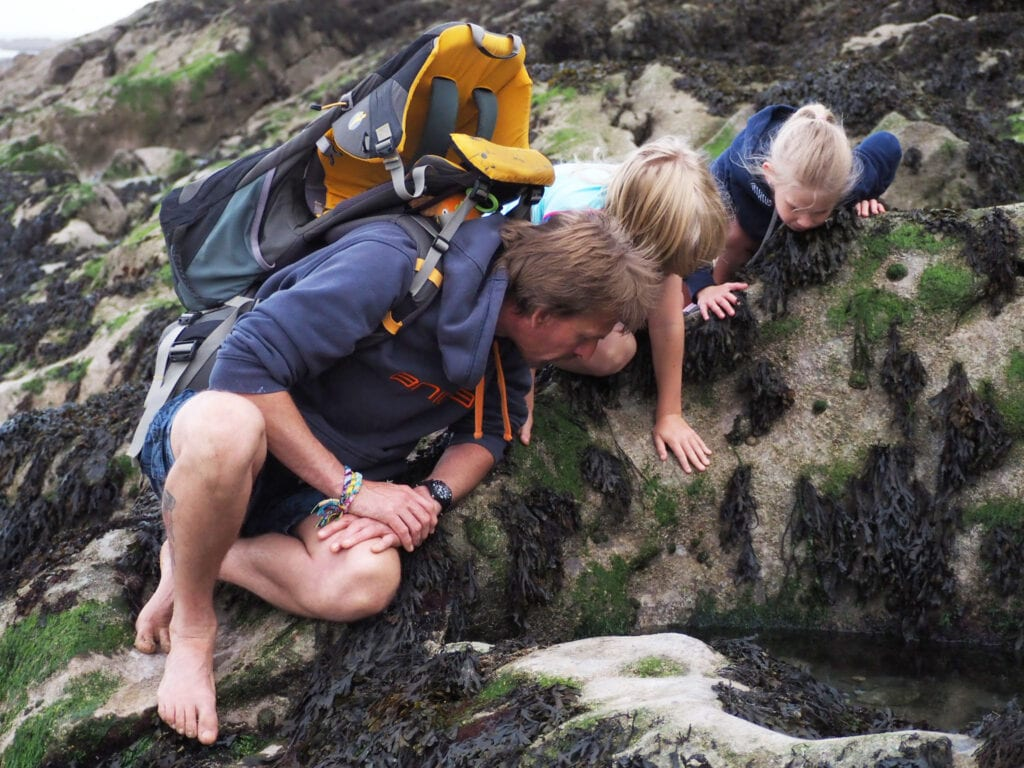 My husband and two children peering into rock pools to see what is inside them