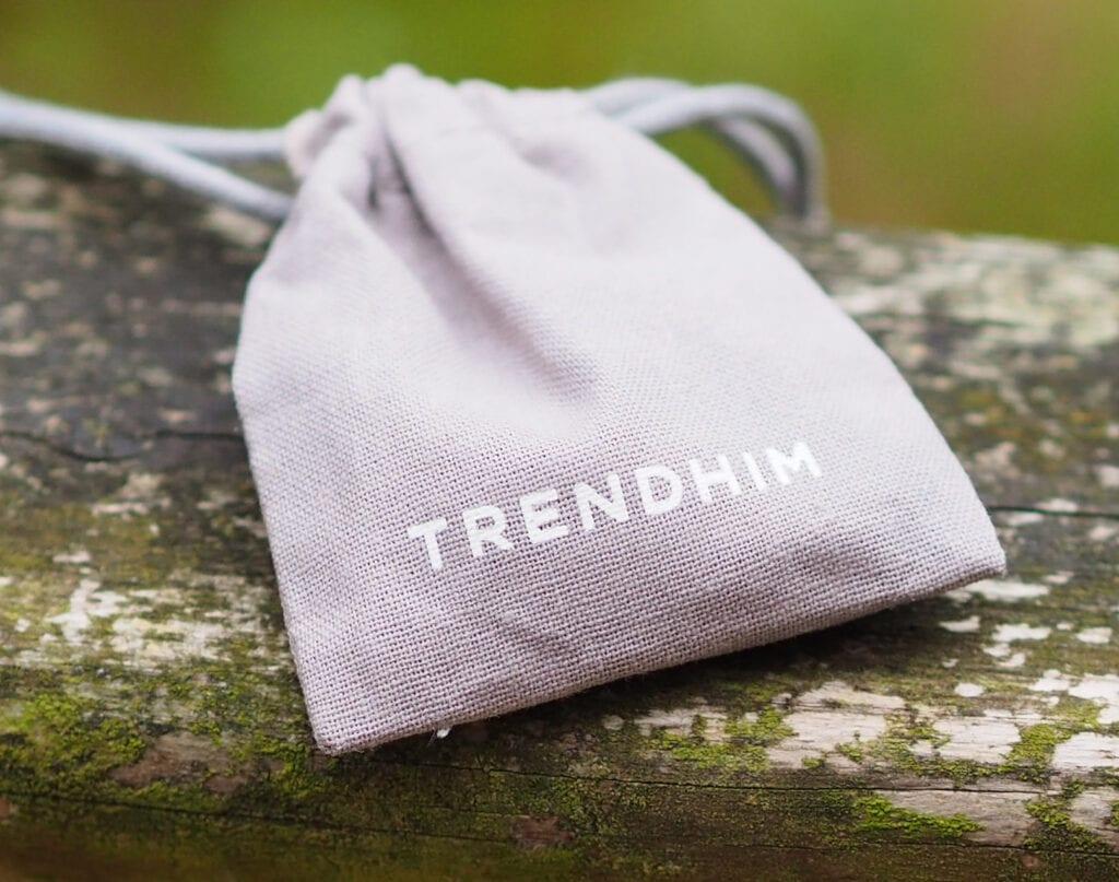 Trend him packaging. Small grey drawstring bag