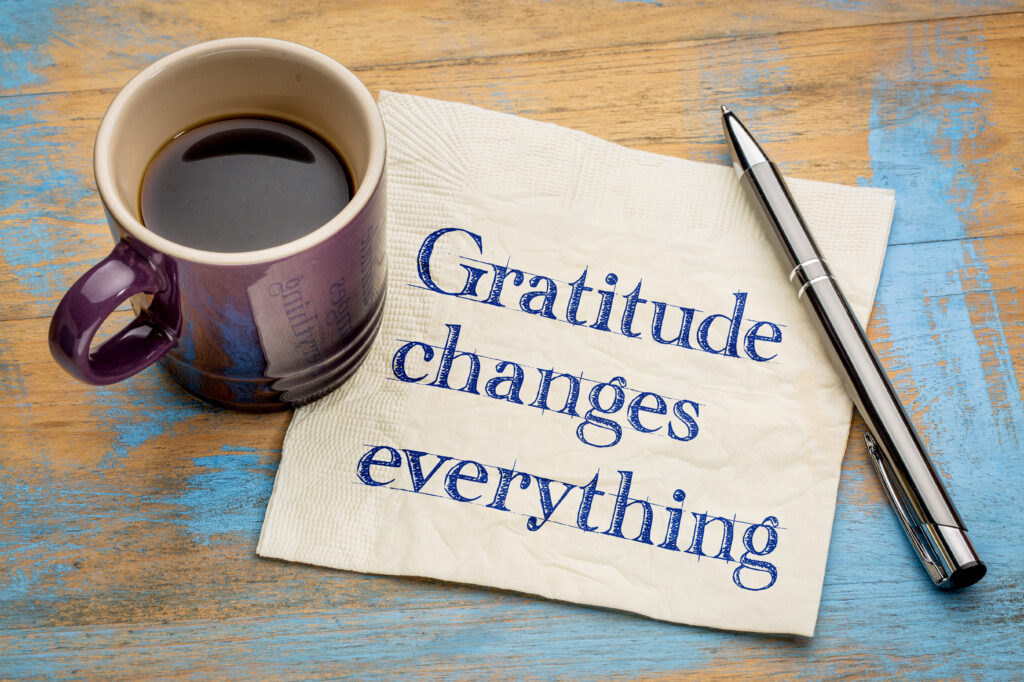 Eighteen Ways to Introduce Gratitude into Your Life - Gratitude changes everything - handwriting on a napkin with a cup of espresso coffee