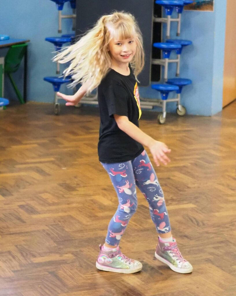 Aria learning to spin in dance class